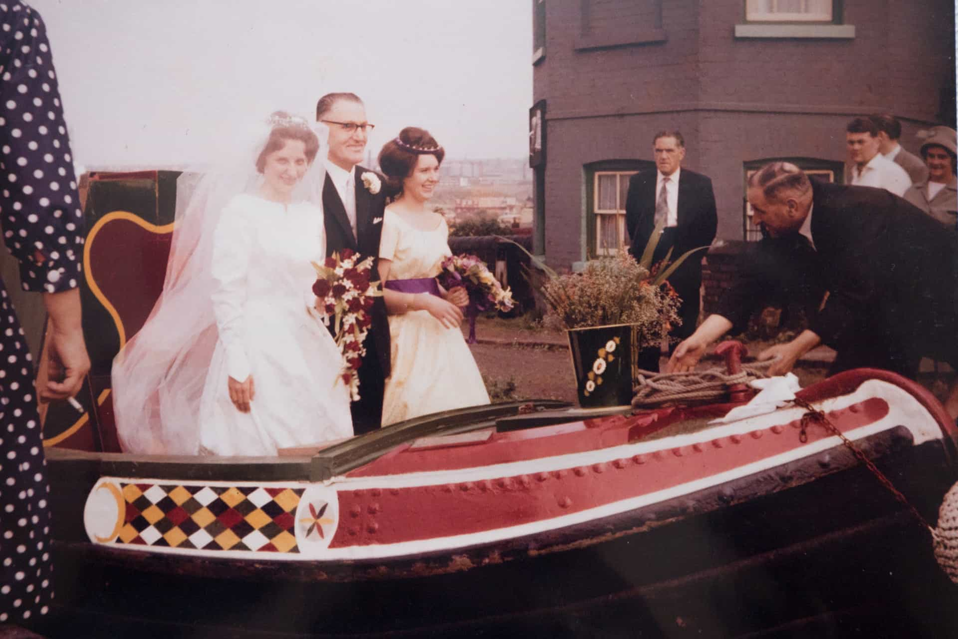 Ruth Collins, neé King, on her way to her Wedding to Conrad Collins on board her friend's boat with her father, Will King and sister, Christine King in 1961.