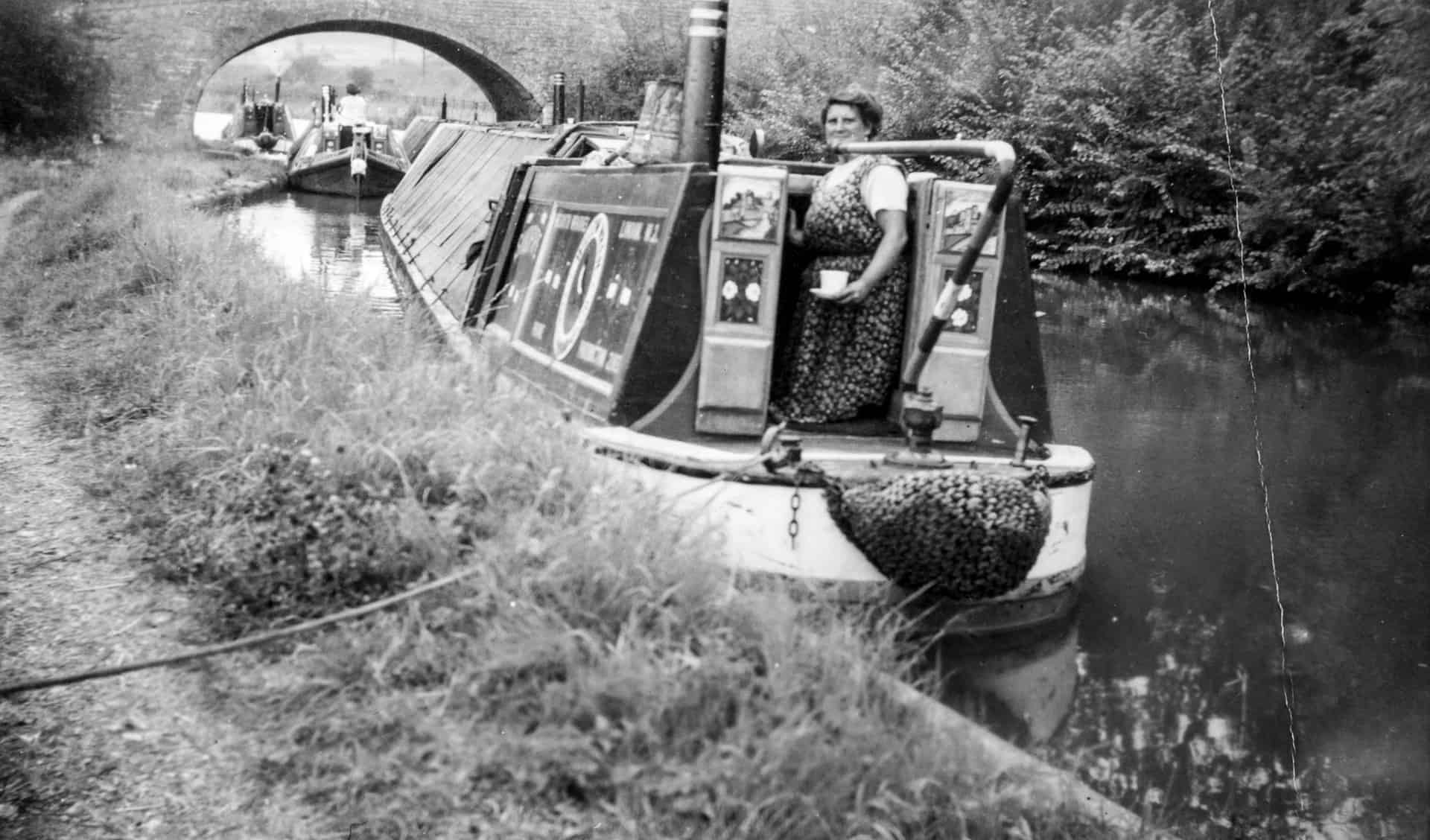 Busy canal scene, location unknown, c 1950s