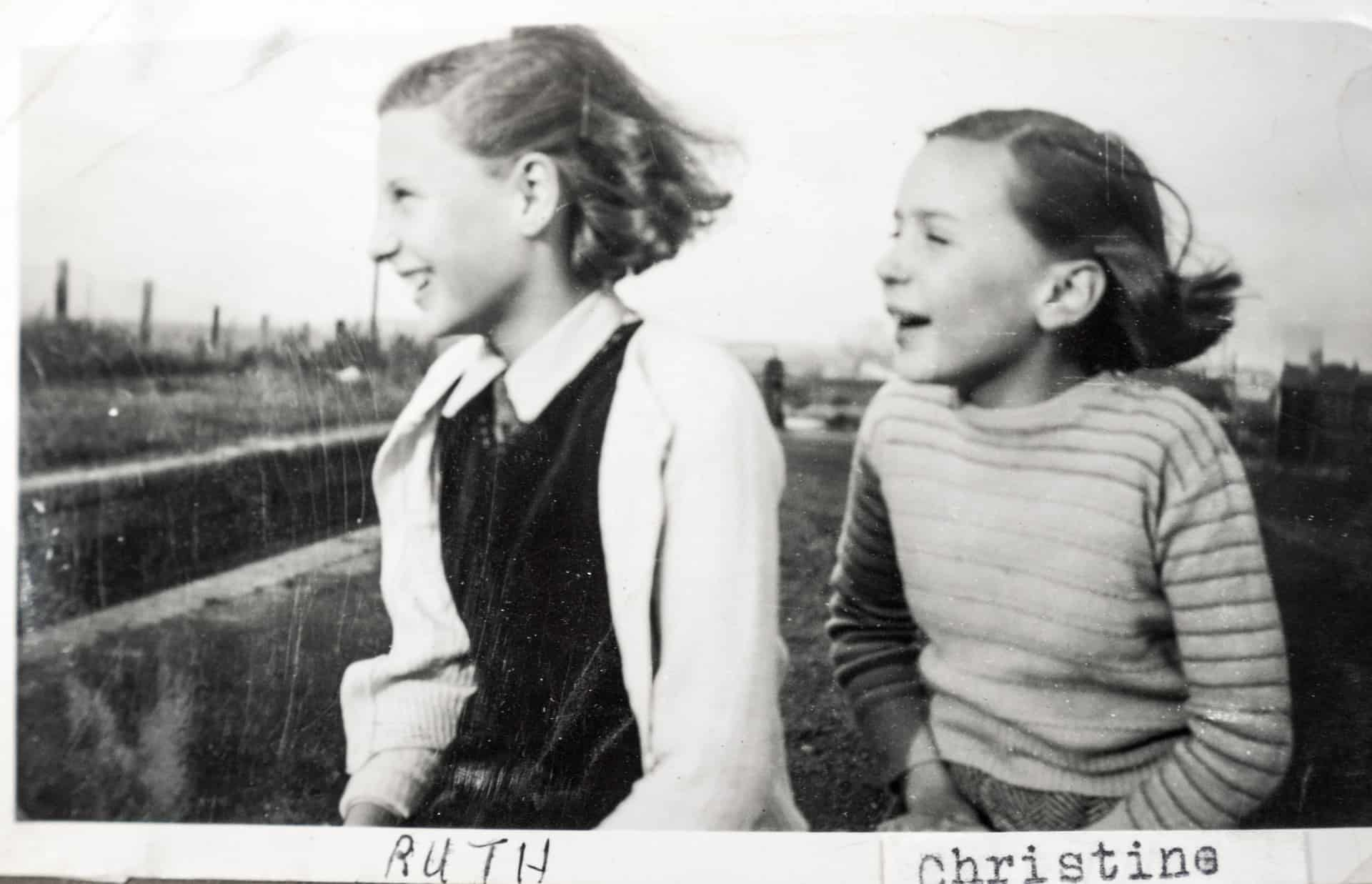 Ruth and her sister Christine sitting on Brades Hall Locks, 1949, taken by their father, Will King.