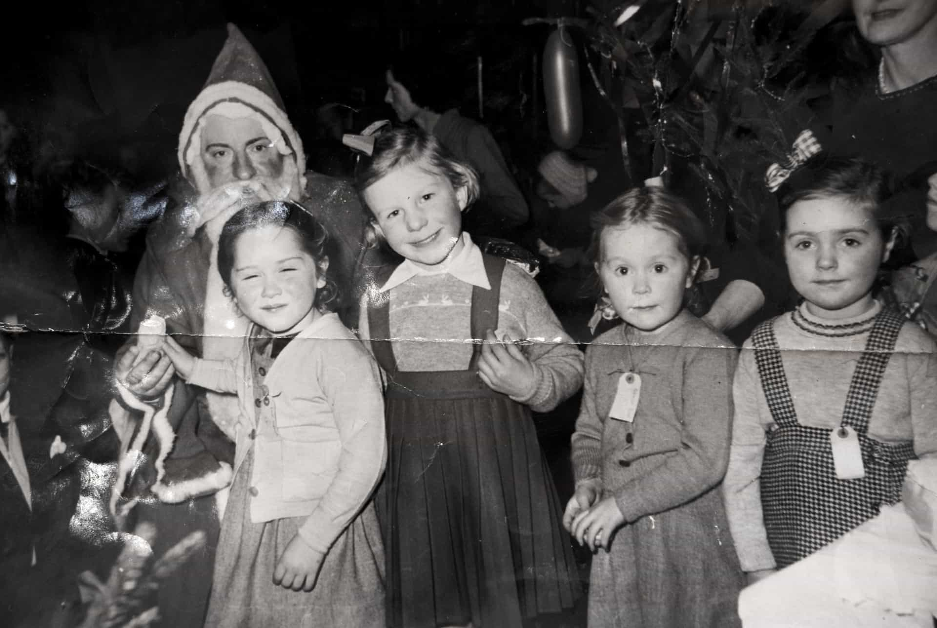 This one here, well you had to wear labels when you went to the works Christmas Party. That's me there on the far right. It was down at T.I. (Tube Investments). I was about 4 or 5, so maybe it's about 1952.