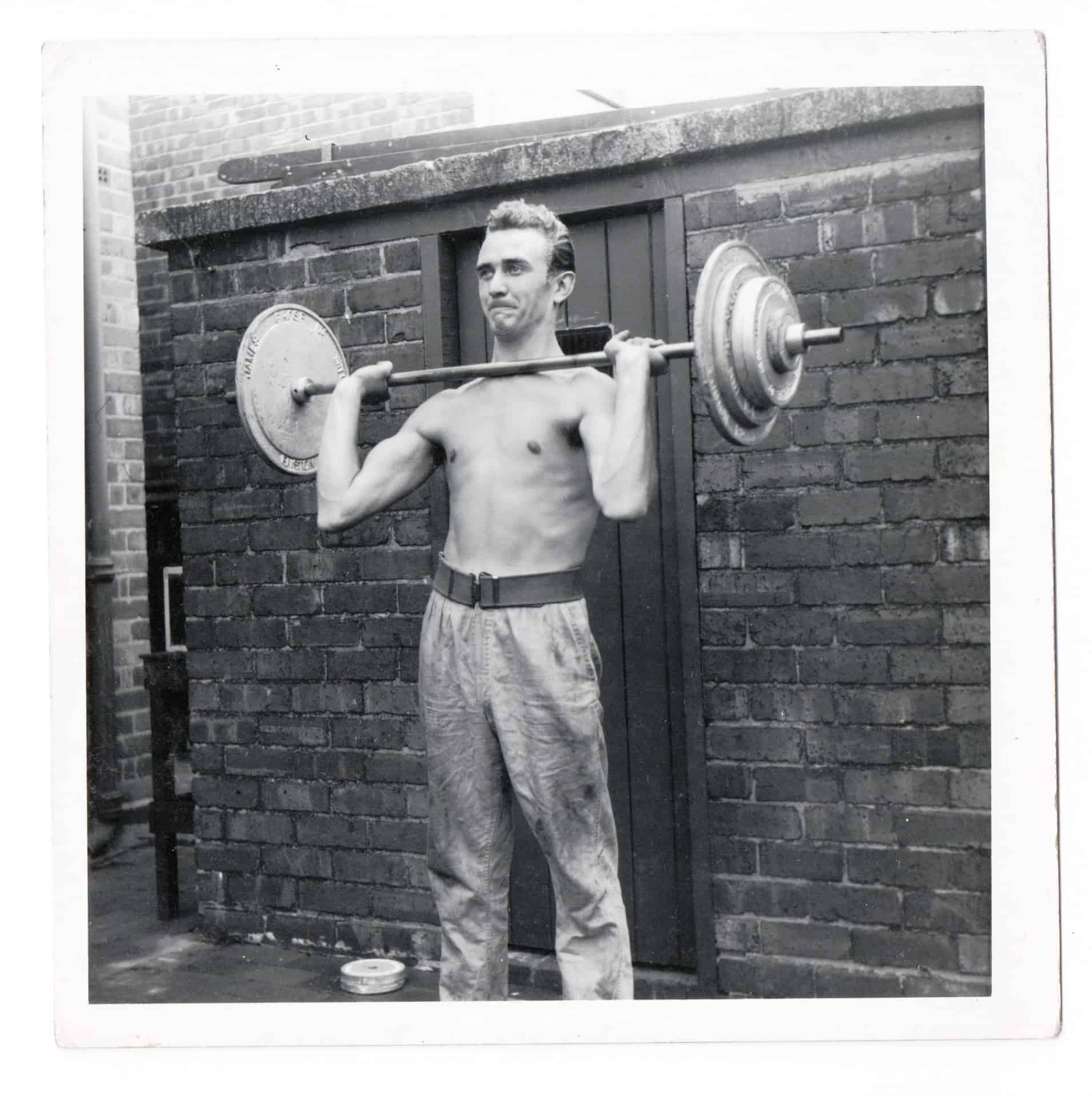 This is uncle Bill lifting weights. He had what was then probably all the latest gadgets. The bench, weights, belts and grips were all kept in his bedroom and even after he died nan never got rid of them.