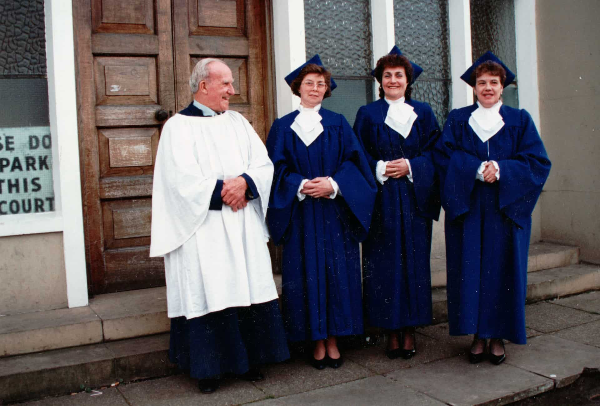 This is me outside church, and we are wearing our choir robes, we don't have a choir now as we don't have an organist come and play.