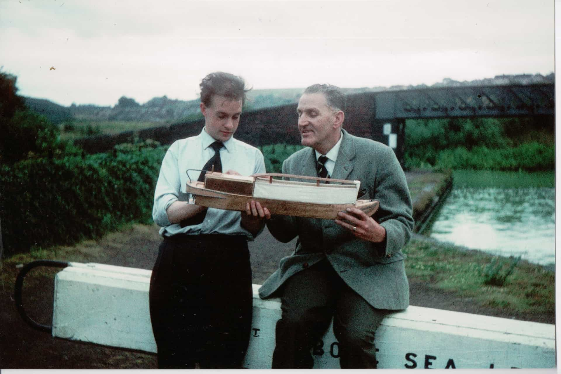 Conrad Collins shows his Father in Law, Will King, a model boat that he had made for him. Some of Will's collection of Canal paraphernalia is housed with the Birmingham Museums Trust and his extensive photo collection appears under the 'Collections' part of this website.