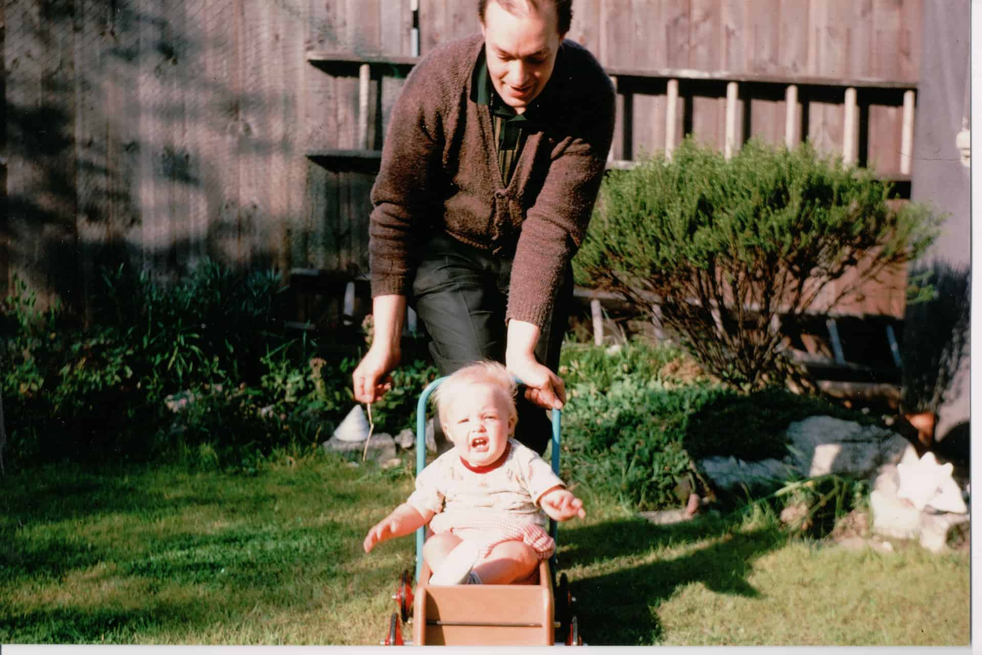 Conrad Collins with his son, Peter in the family garden, Oldbury, late 1960s.
