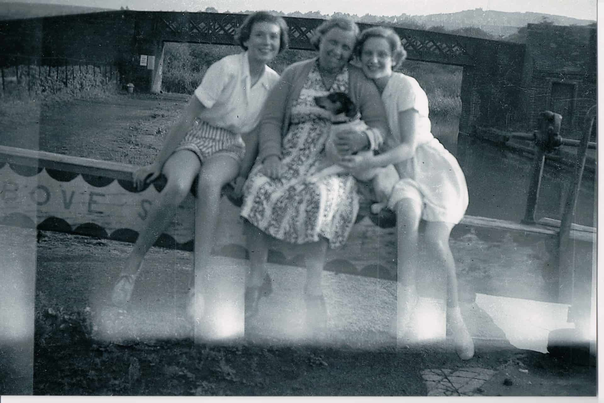 Ruth with her Mum, sister Christine and pet dog, Patch, taken mid 1950s.