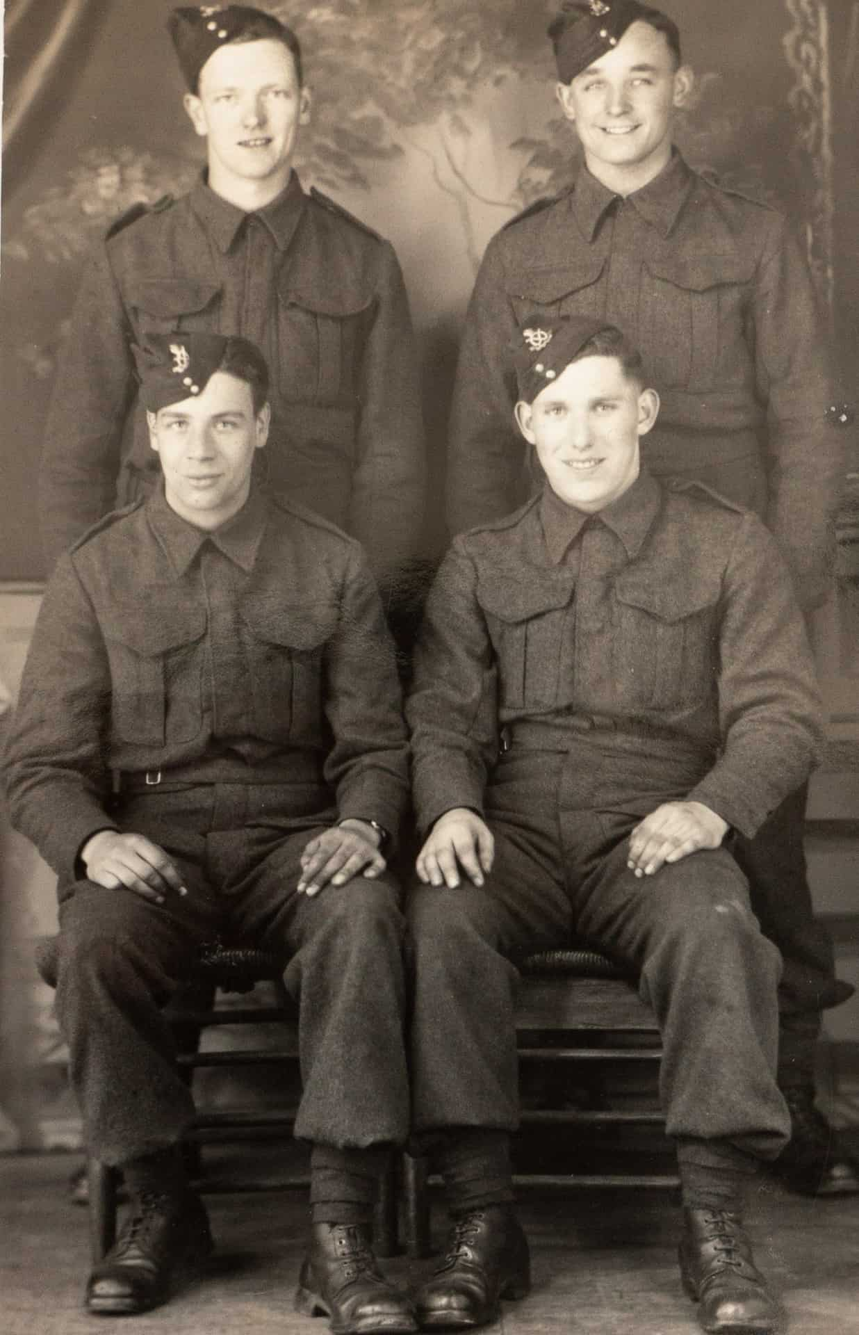Borden, Hampshire. Left to right, clockwise: William Poulton - escaped at Dunkirk; Sammy Simmons: captured in Belgium 1940; Jim Smith: ecscaped at Dunkirk; Harvey Woodhouse: Caputred in Belgium 1940.