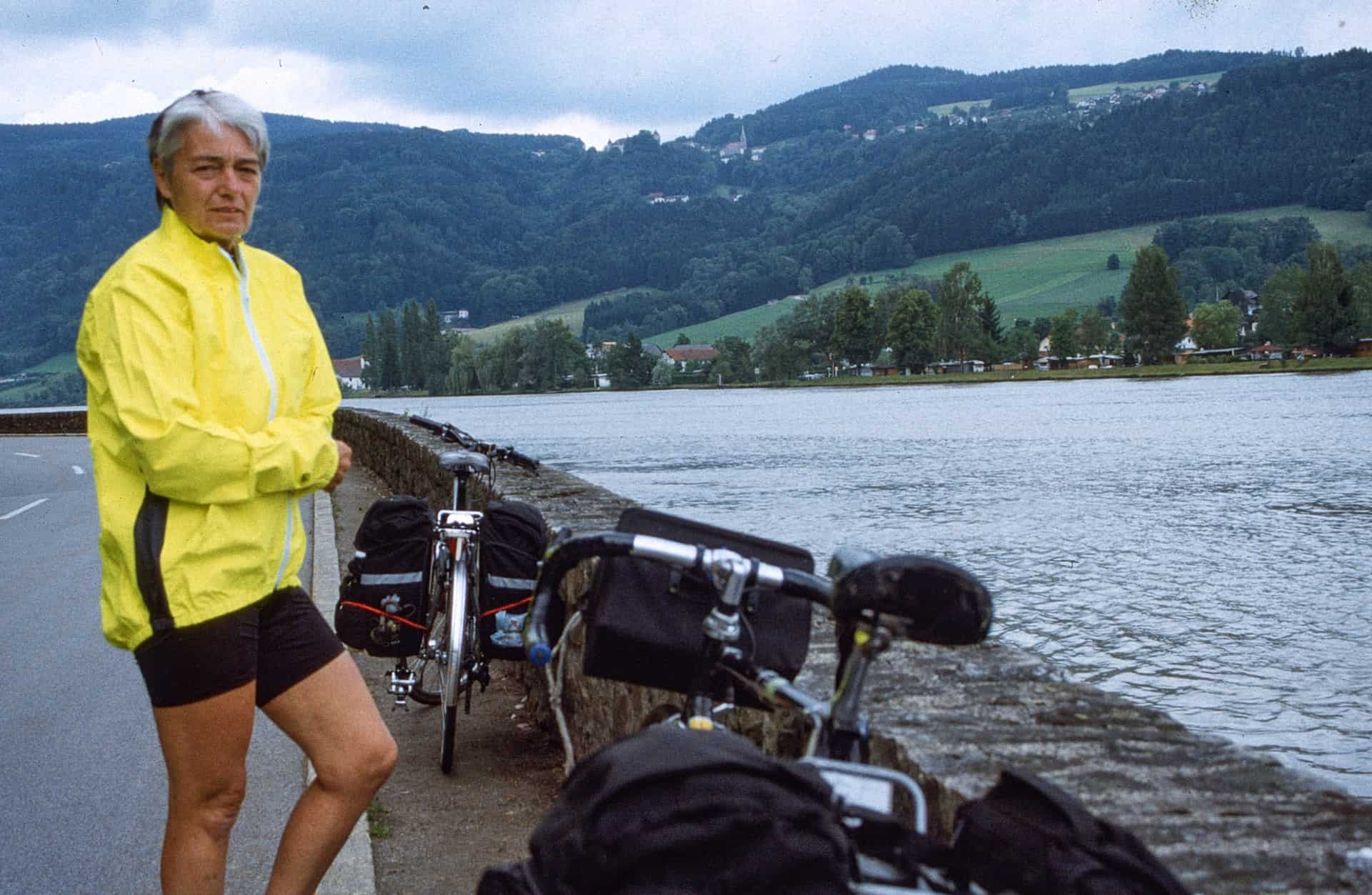 "Cath Mansell cycling along the Danube in Germany with husband Bob June 12  -26 2004. From Bob's diary: ""What an adventure for us. So many new things, new friends etc. Cyclists by the hundreds. Flowers by the hundreds""."