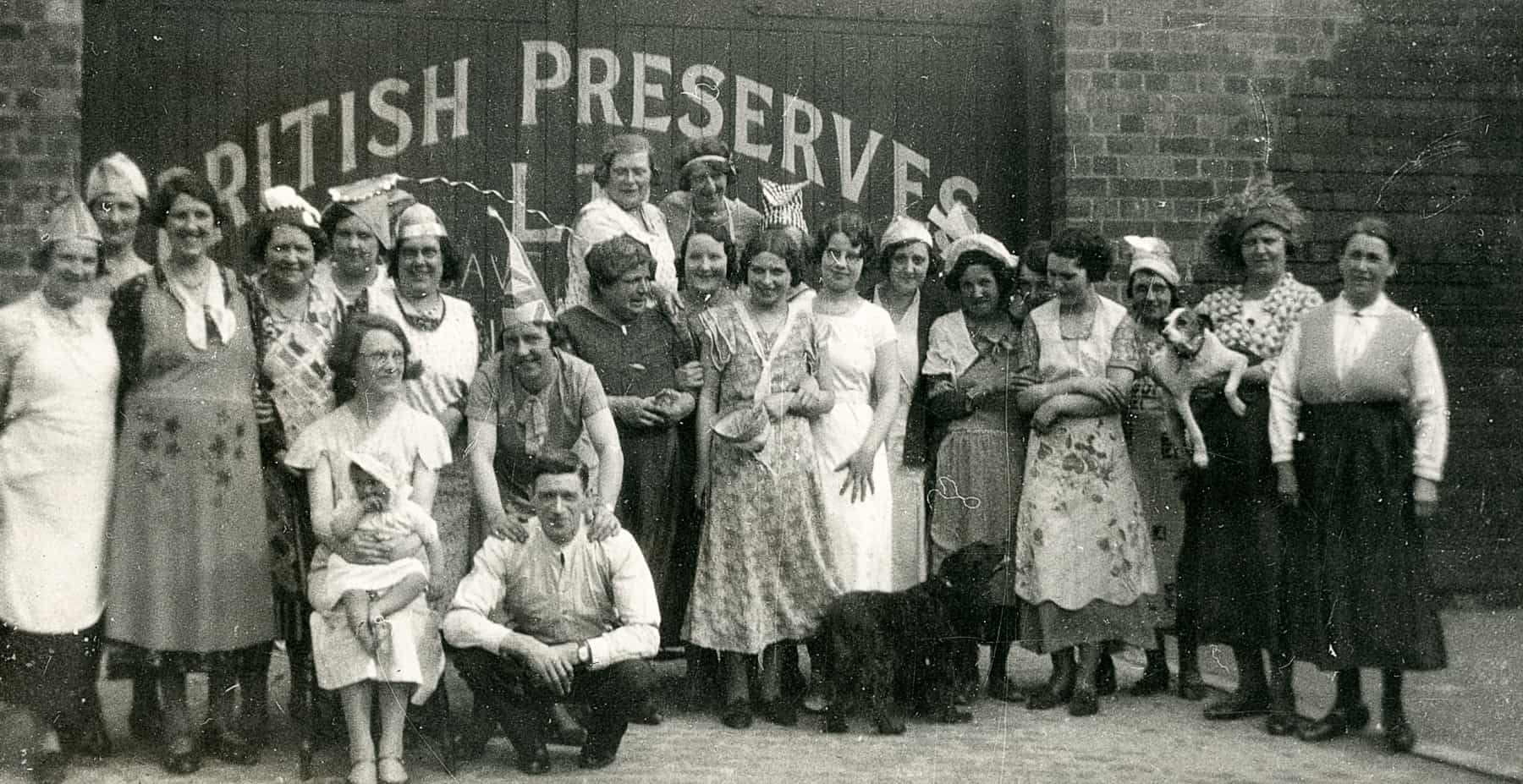 Workers celebrating outside British Preserves Factory, Smethwick. Probably taken at King George's Coronation in 1937