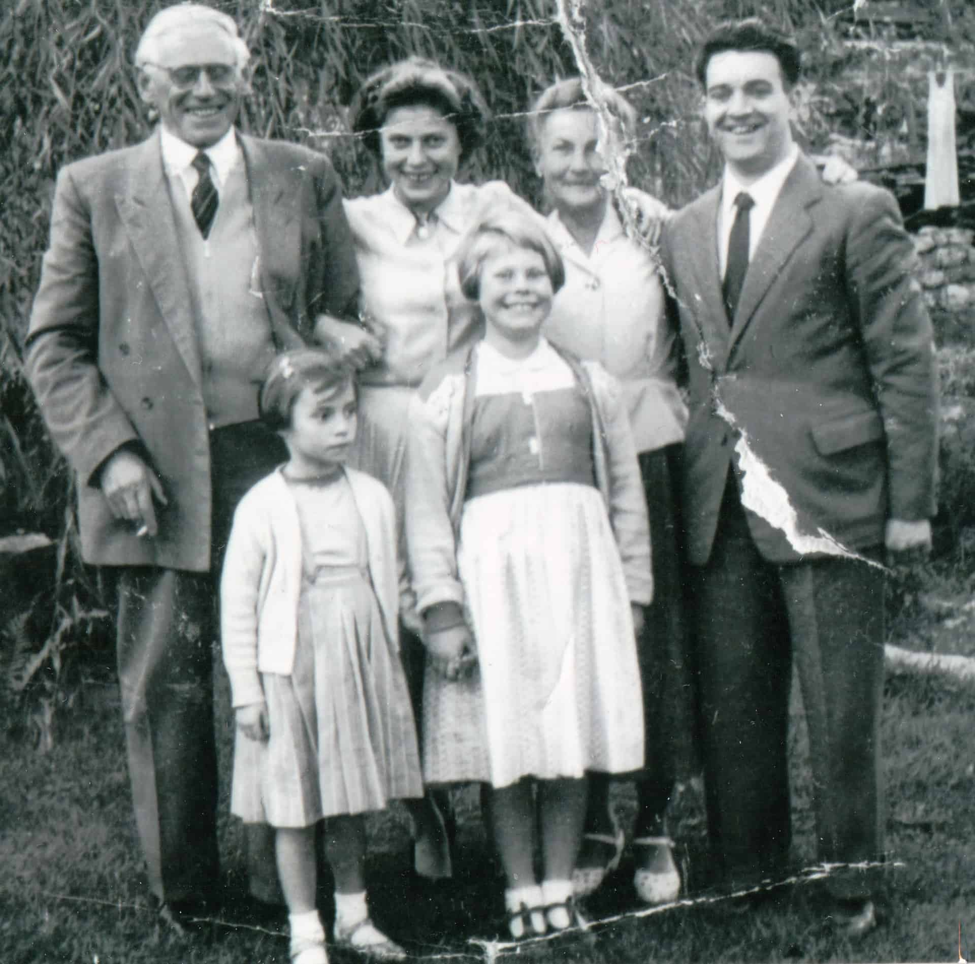 Jackie (front) with her German grandparents, sister, and mum and dad taken about 1955