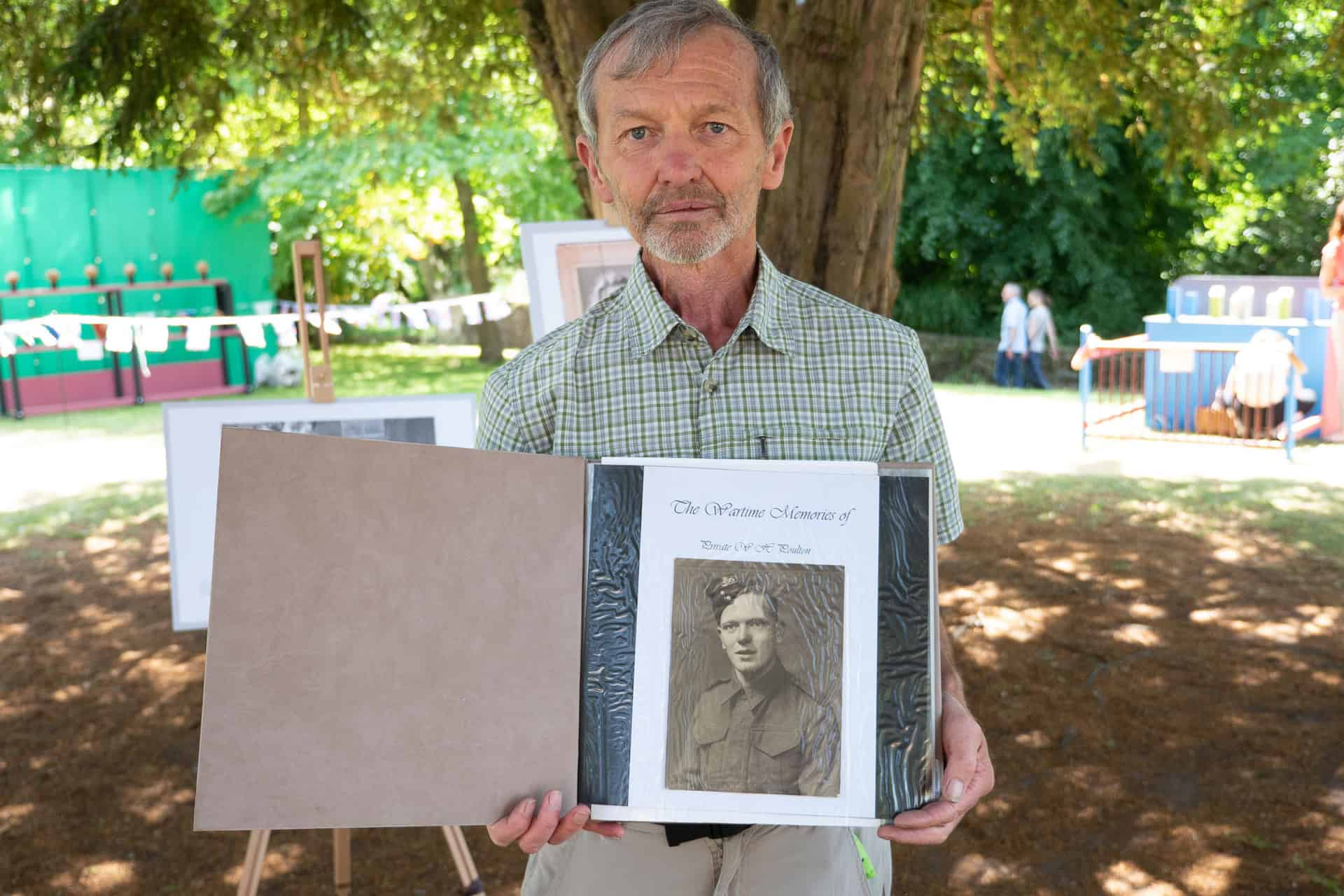 Mike Poulton shows off the album he made about his father's experiences of WW11.