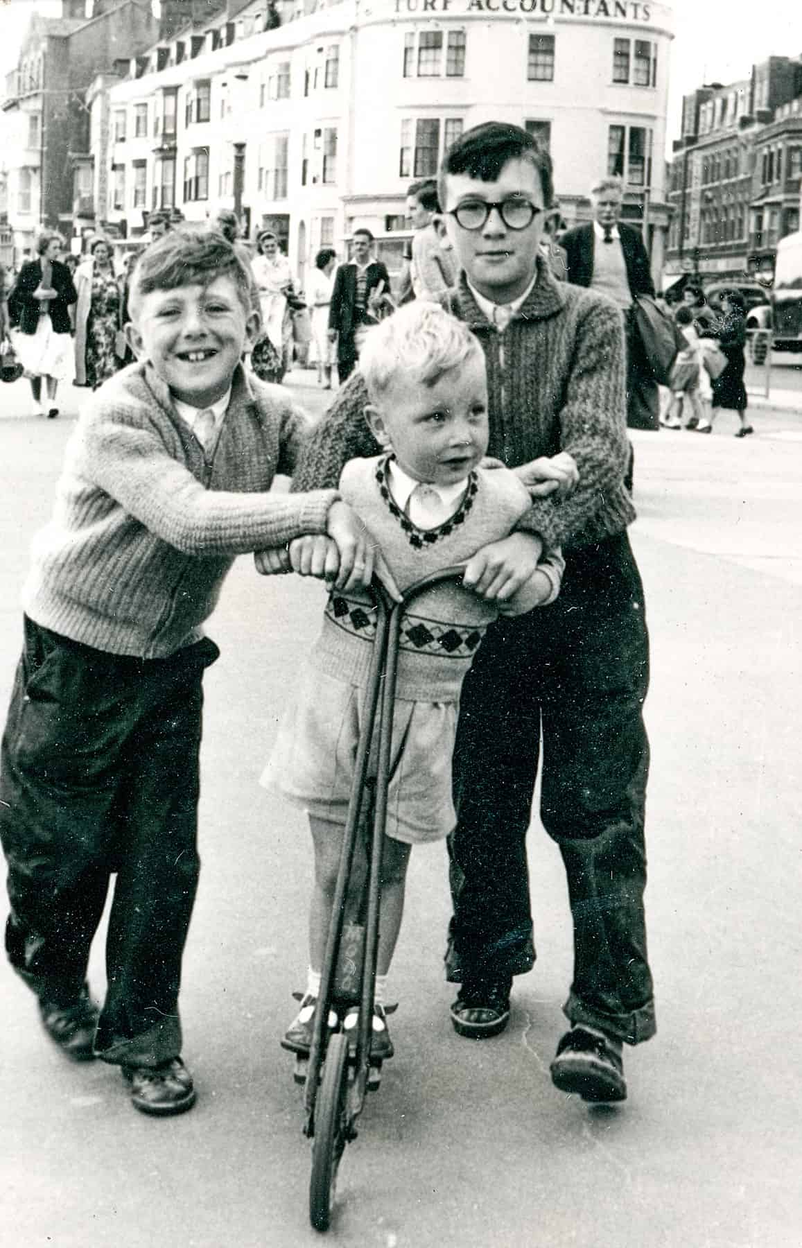 That's me on the scooter on holiday in Weymouth, and that's my cousin Clive and my other cousin Leonard. I must have been about four I would have thought.