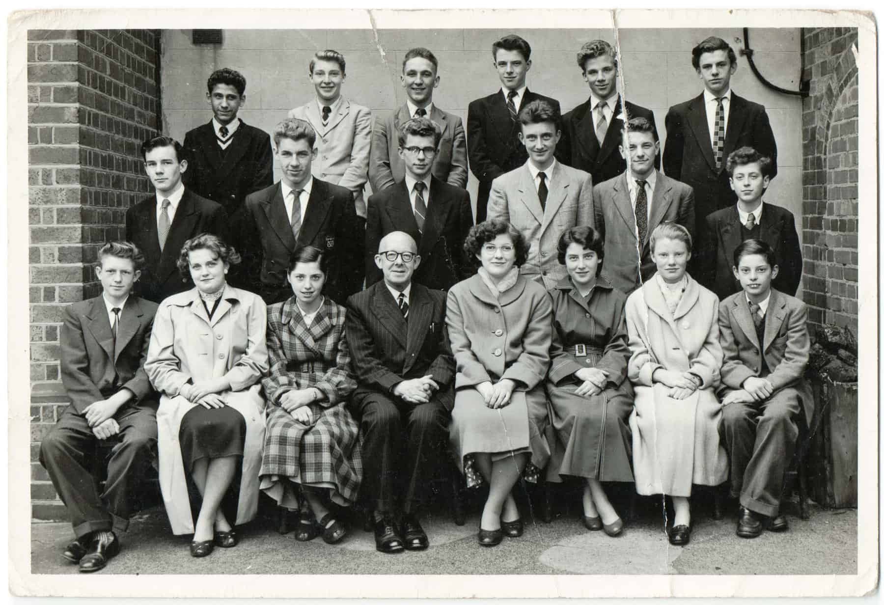 Gary: This is a group photograph from 1956 when I started as an apprentice at Chance Brothers in Smethwick. All the apprentices who were taken on at that particular time had their photograph taken with a managing director. There was all different trades and office staff. I am in the middle row, third from the left.