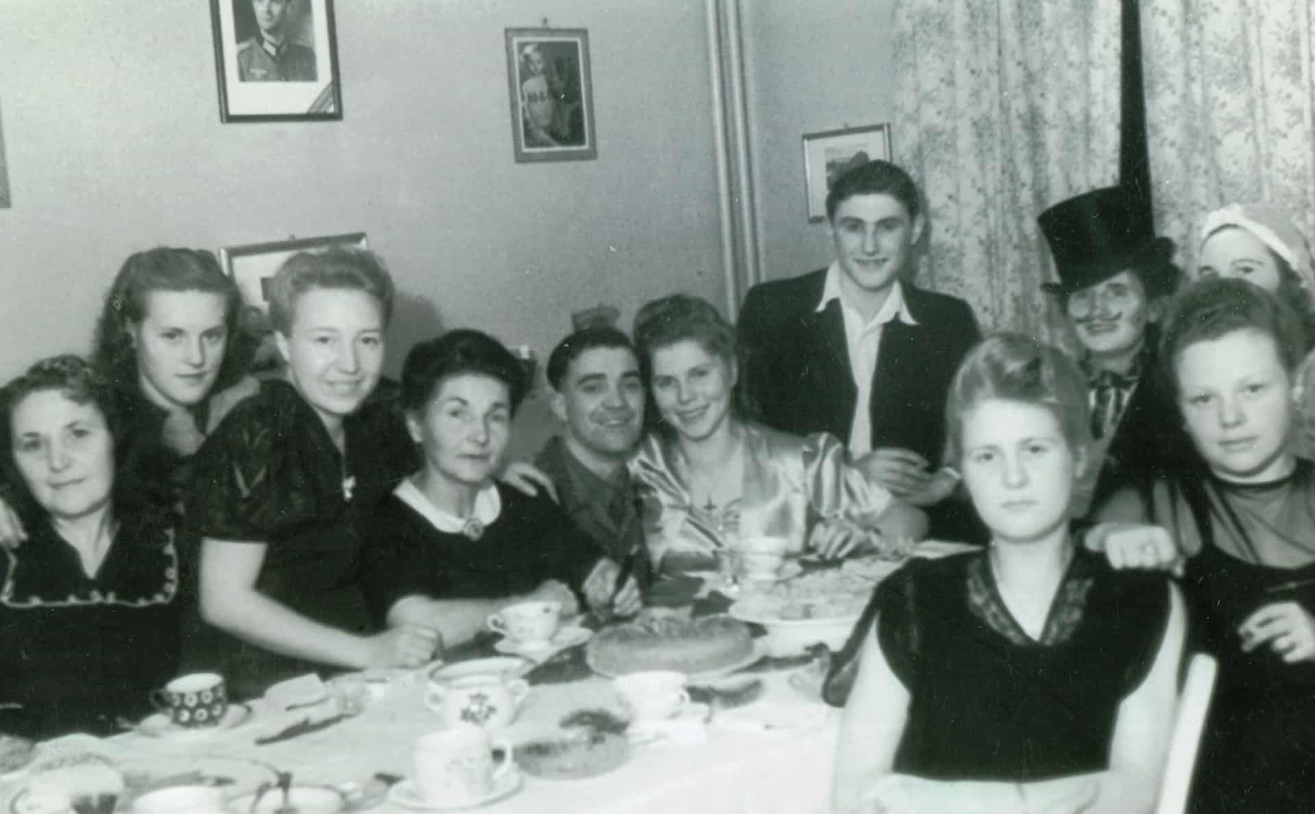 "Jackie's dad and mum (centre) at the family home in Germany. ""That's got to be their wedding day, in Germany.   I think my dad was in Germany for two years. I think he stayed in Germany because he fell in love with my mum."""
