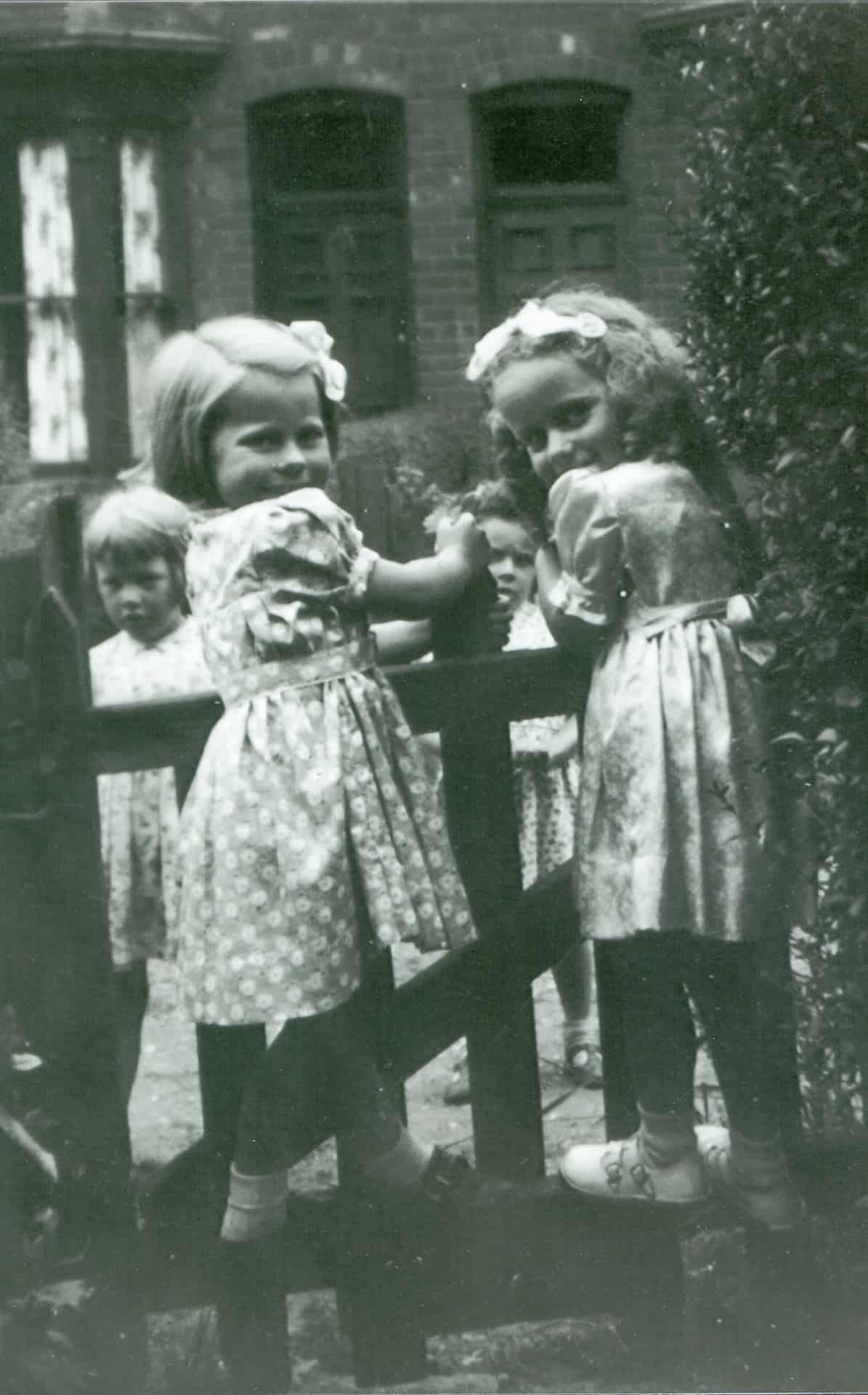 Jackie's sister Linda (left) on the gate with friends about 1951.