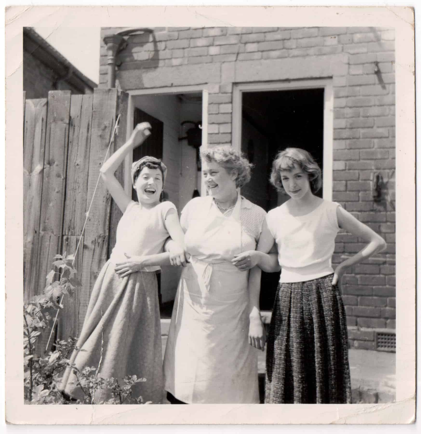 Dorothy: Oh yes, I should think I was about 17there, with a friend Wendy Seeney and her mum their back garden Warley. There were outside toilets even in those days.