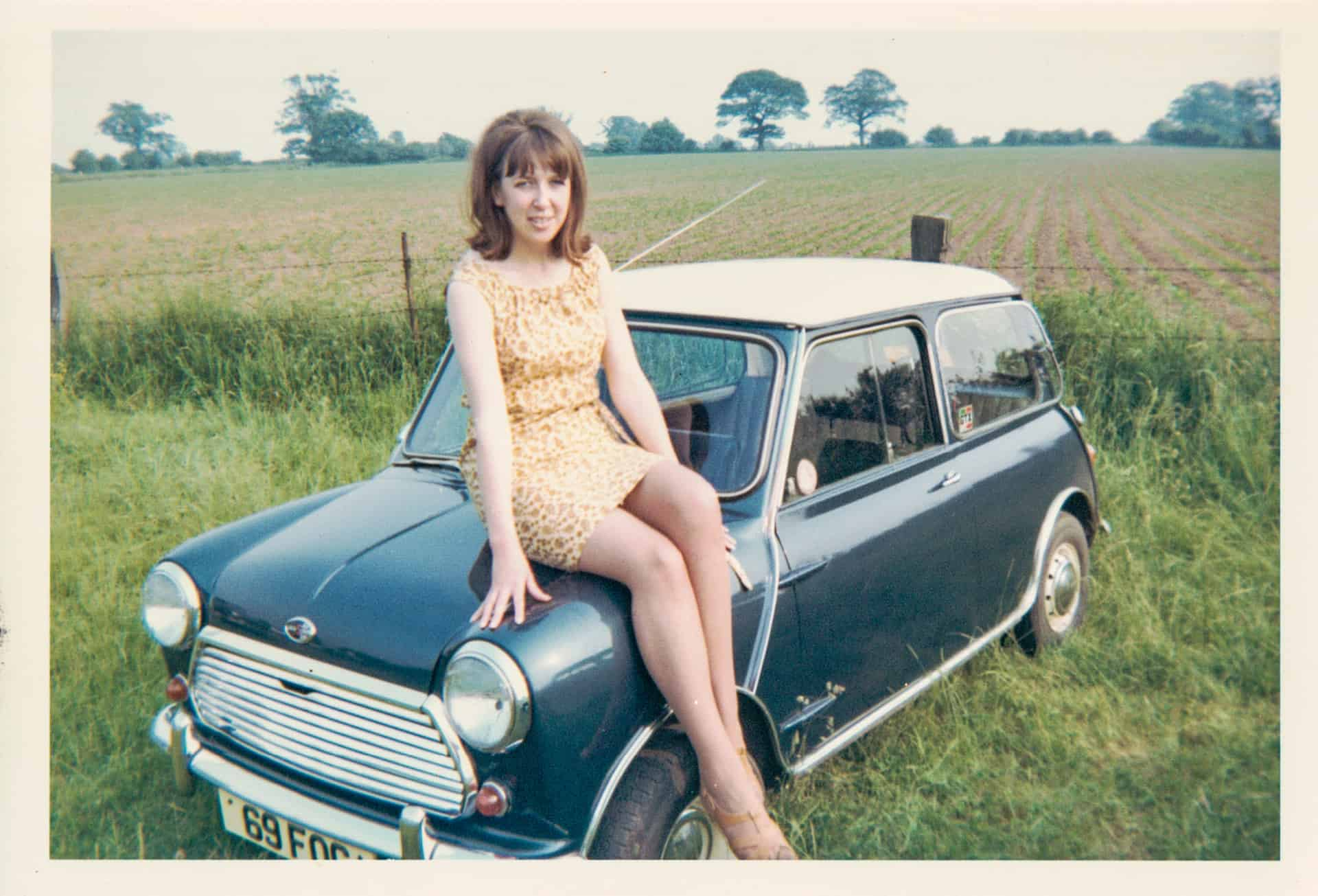 This is my wife Betty with my Mini taken in 1973. At the time we had just arrived in Curborough Racetrack where I had competed before. I used to do a lot of rallying with the cars back then.