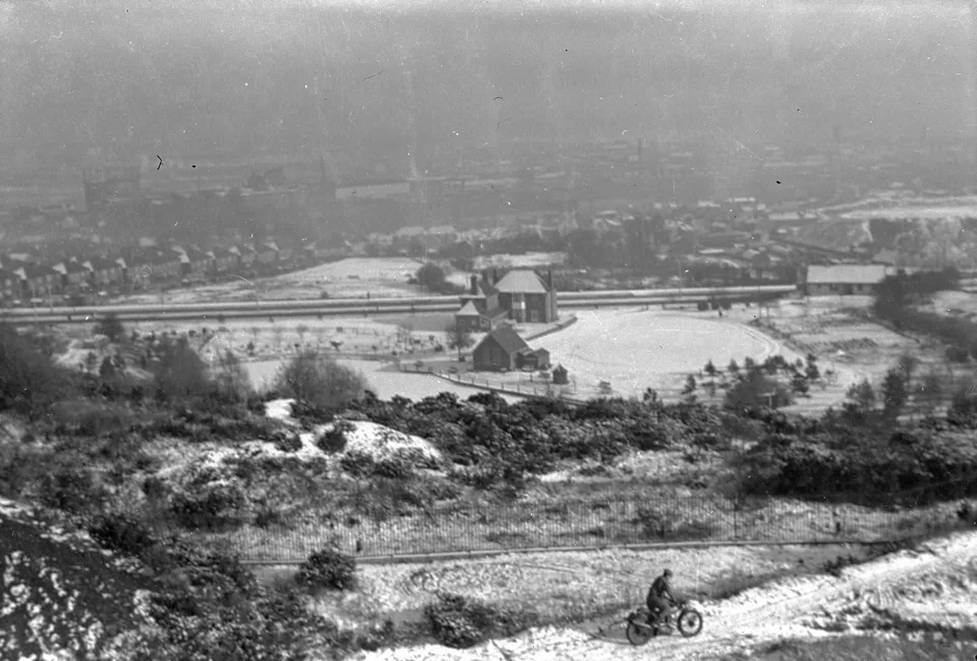 A winter's day in 1951 taken from Bury Hill. A scramble motorbike practicing with the Edale Estate in the background and the A4123 Wolverhampton New Rd.