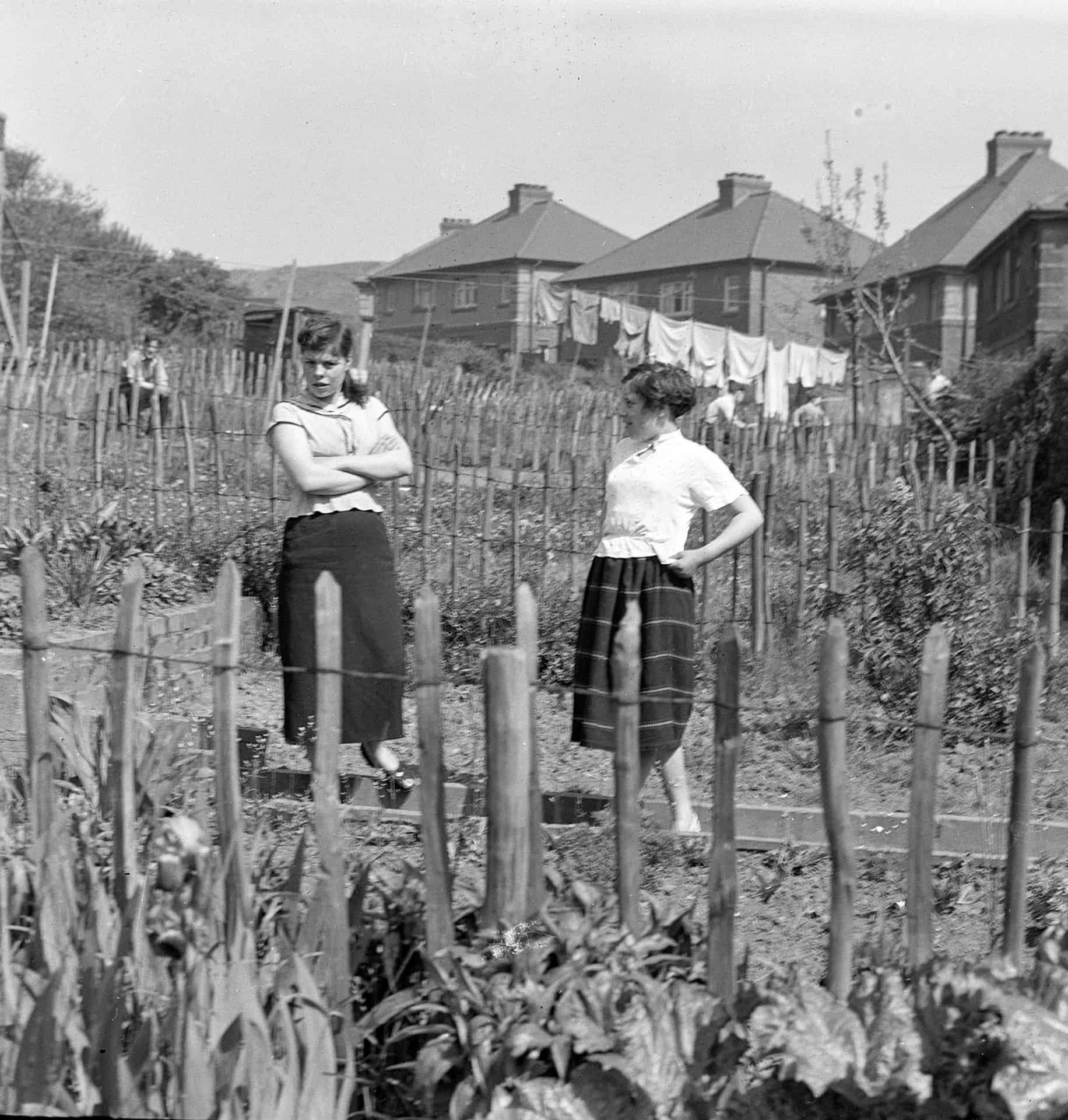This is the Frank sisters from next door. You can see all this picket fencing, that was the council house sort of regulation at the time which was in about the 50s. You didn't have fencing at all like today so you could see what all the neighbours were doing.