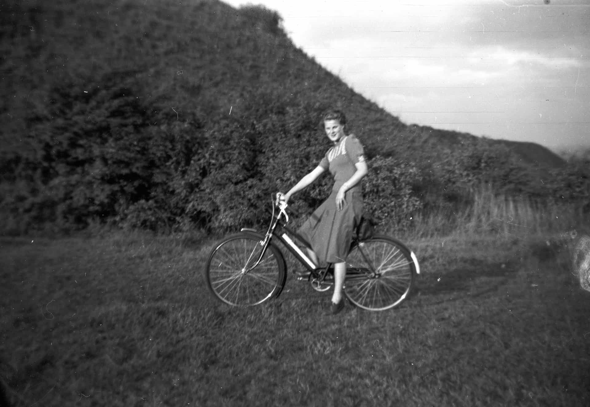 My late sister Jesse showing off her new bike in  1954.