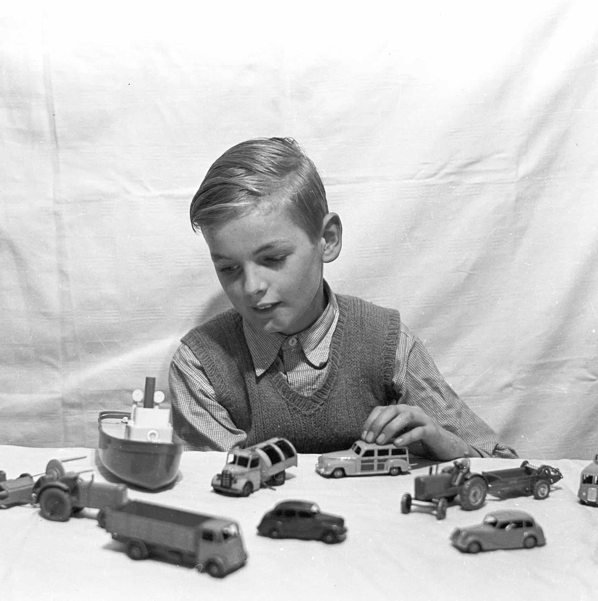Dinky Toys were a great plaything and I still have a number 68 year on. Here I am 9 years only with a refuse collection truck and a set of racing cars. The photo was taken by my dad.