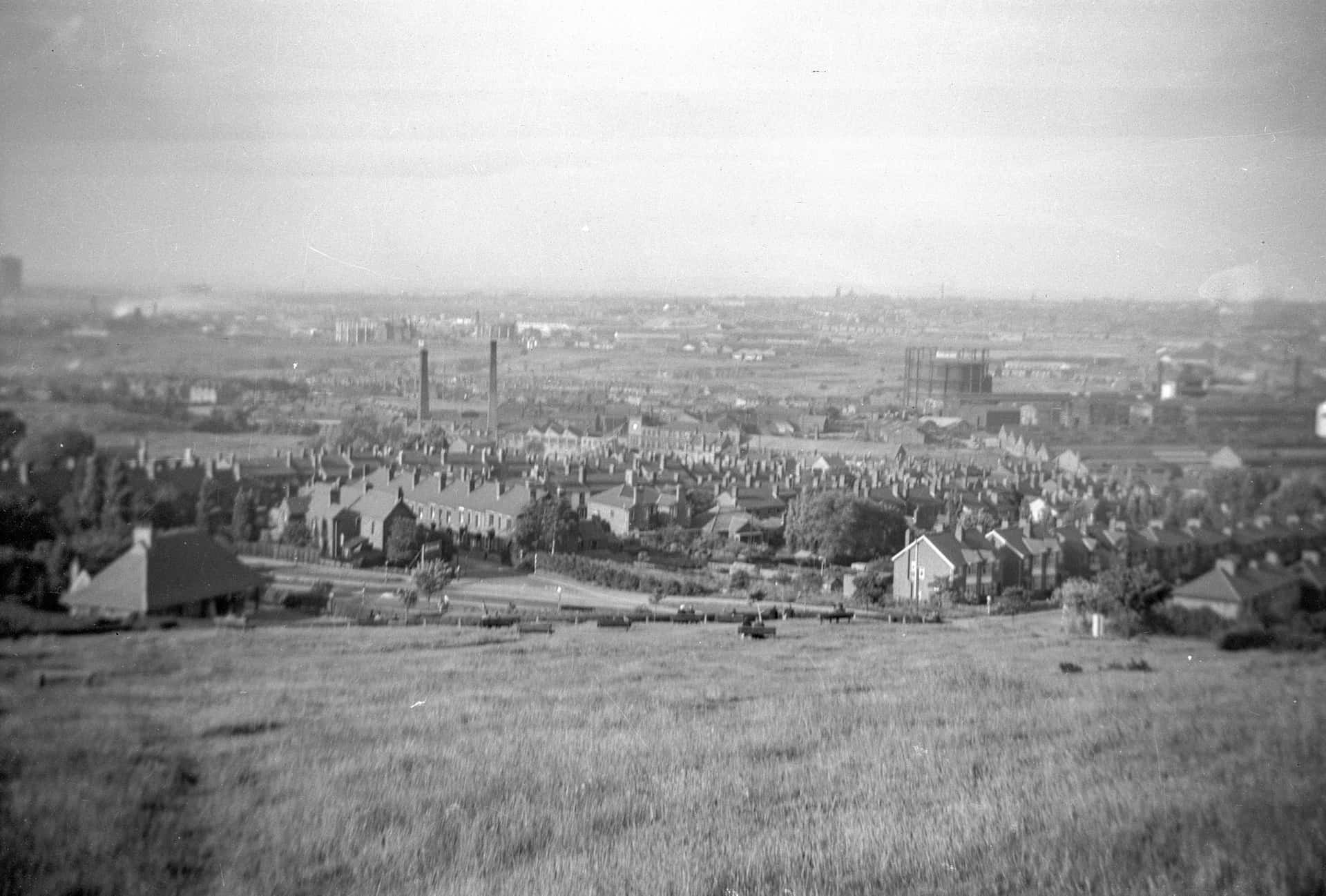 A view from Bury Hill Park taken in 1950. Looking out over Rounds Green, Brades Village and Oldbury. The 2 chimney stacks were the world-famous Brades Steel Works, makers of shovels, pick-axes, trowels, and many other items - some went world-wide.