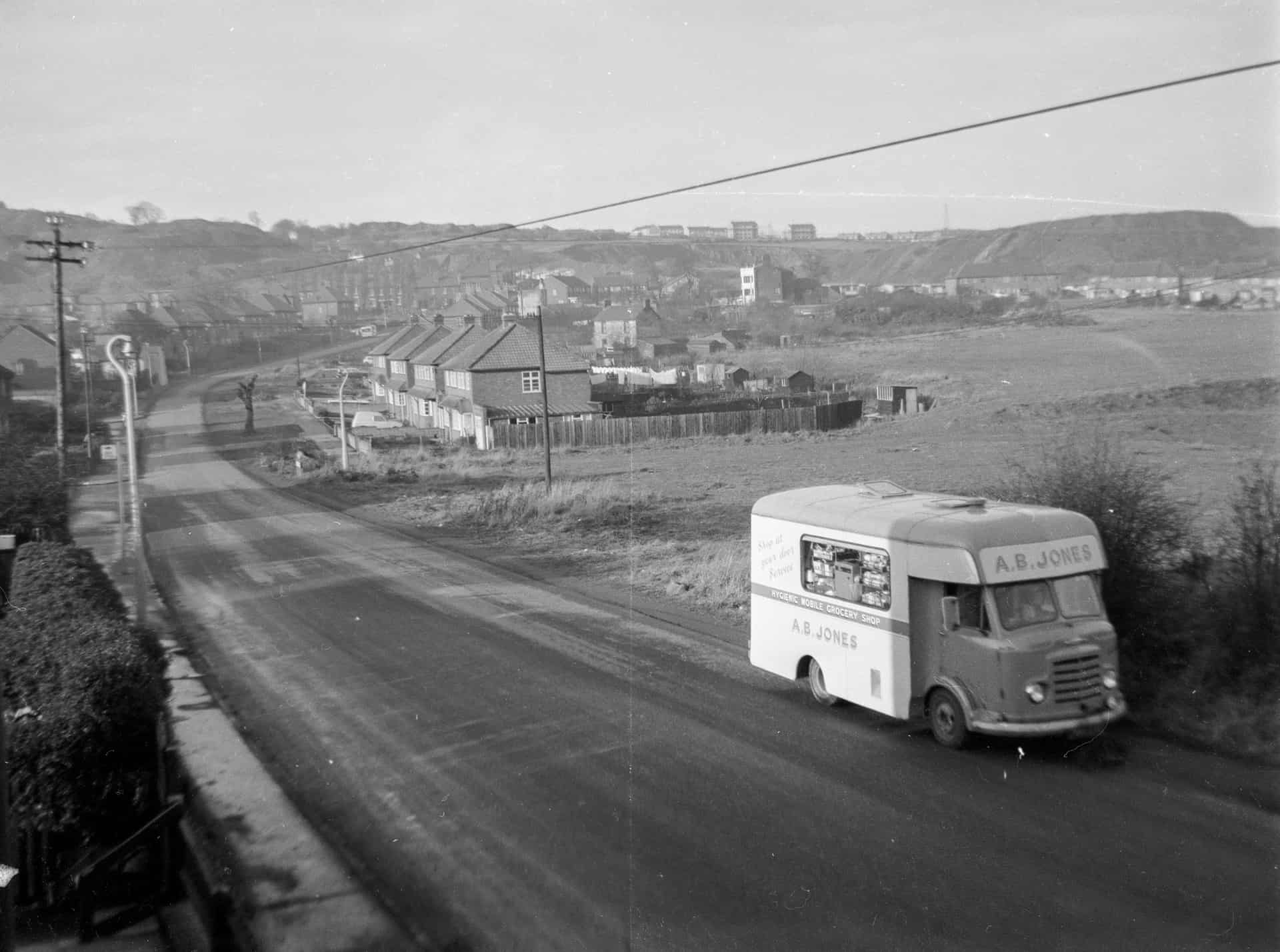 A view taken from the upstairs house in Throne Rd. The spoil heaps from the quarry workings and the outline of the Rowley Hills, the white building upper centre was the old Portway Hall. Throne Road was not yet completed and the Lion Farm buildings had not reached the farm area opposite.