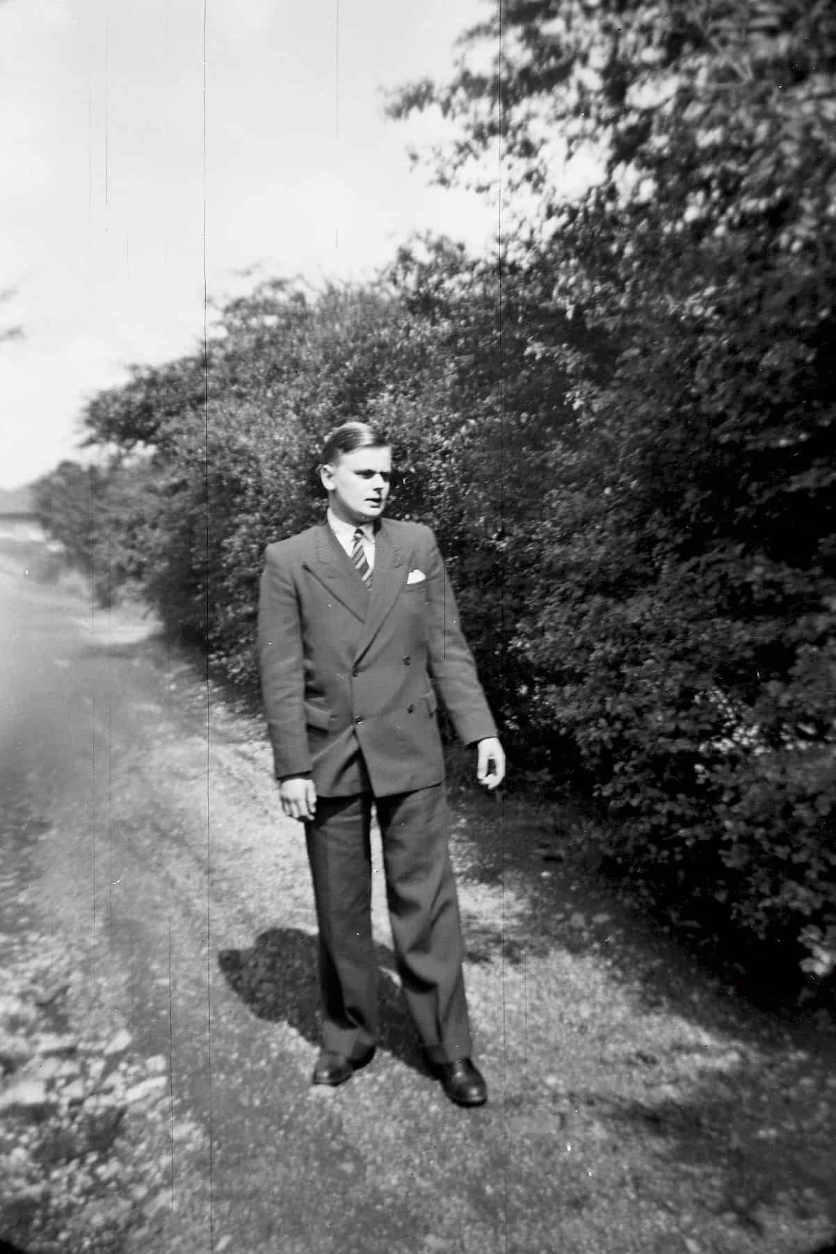 My brother John with his Sunday best walking at the back of our house at Wallace road about 1952.