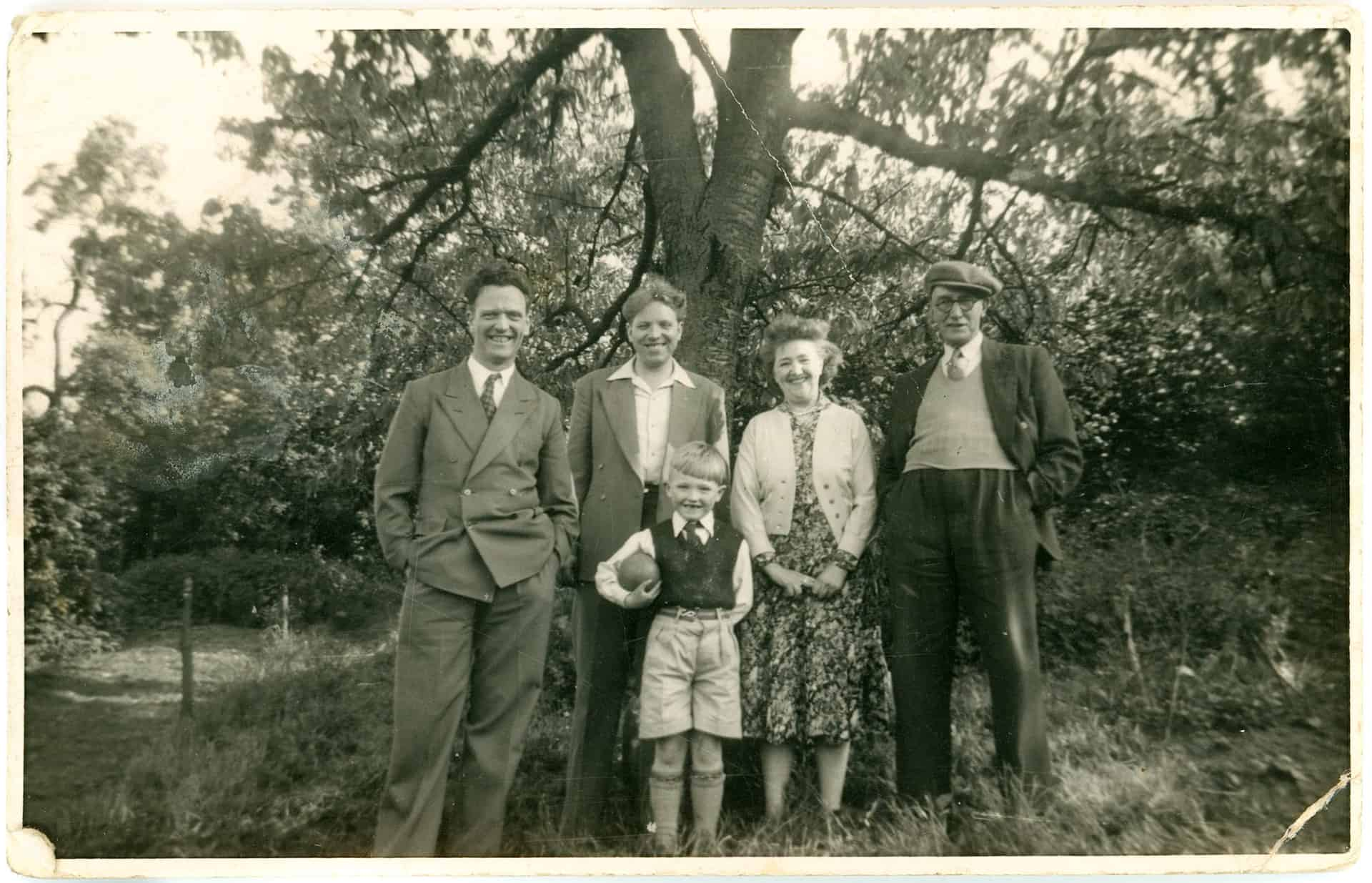 My dad, Uncle Ron, Nanny Lil, Uncle Tom, and me 1950s