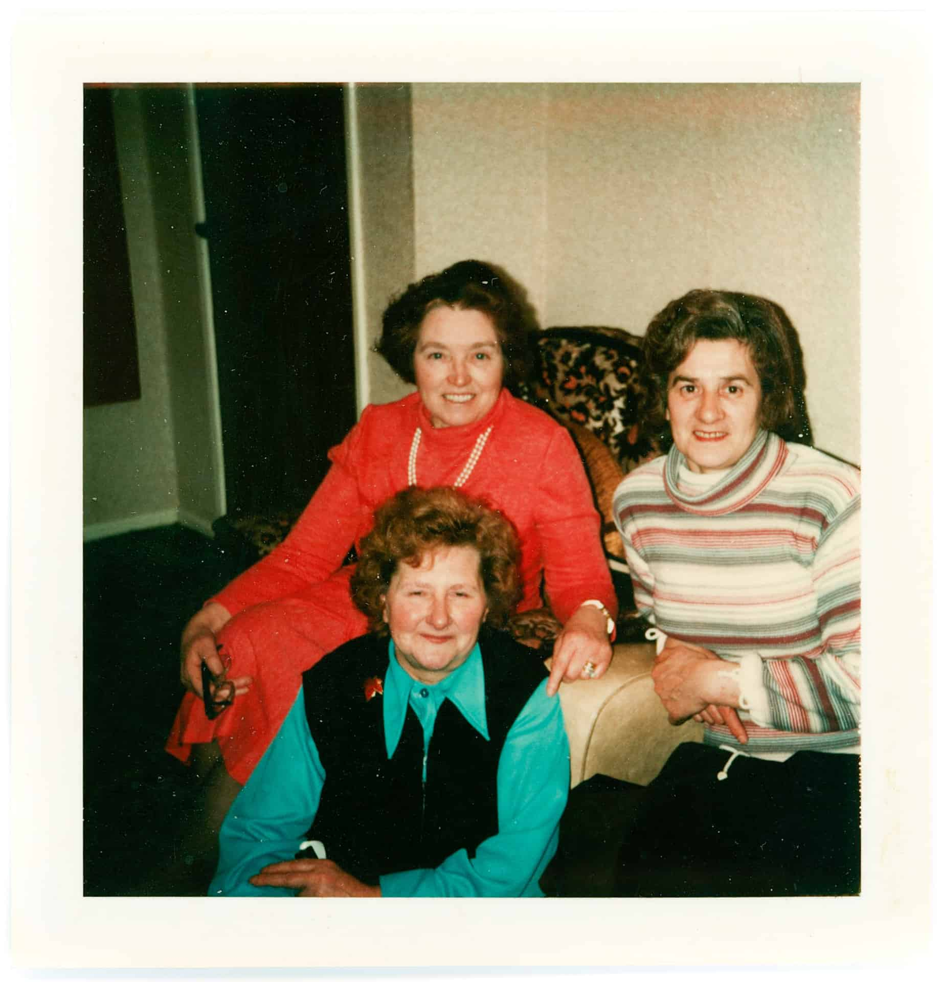 Aunt Rene (in red) and Aunt Joyce with Mom in the foreground 1970s