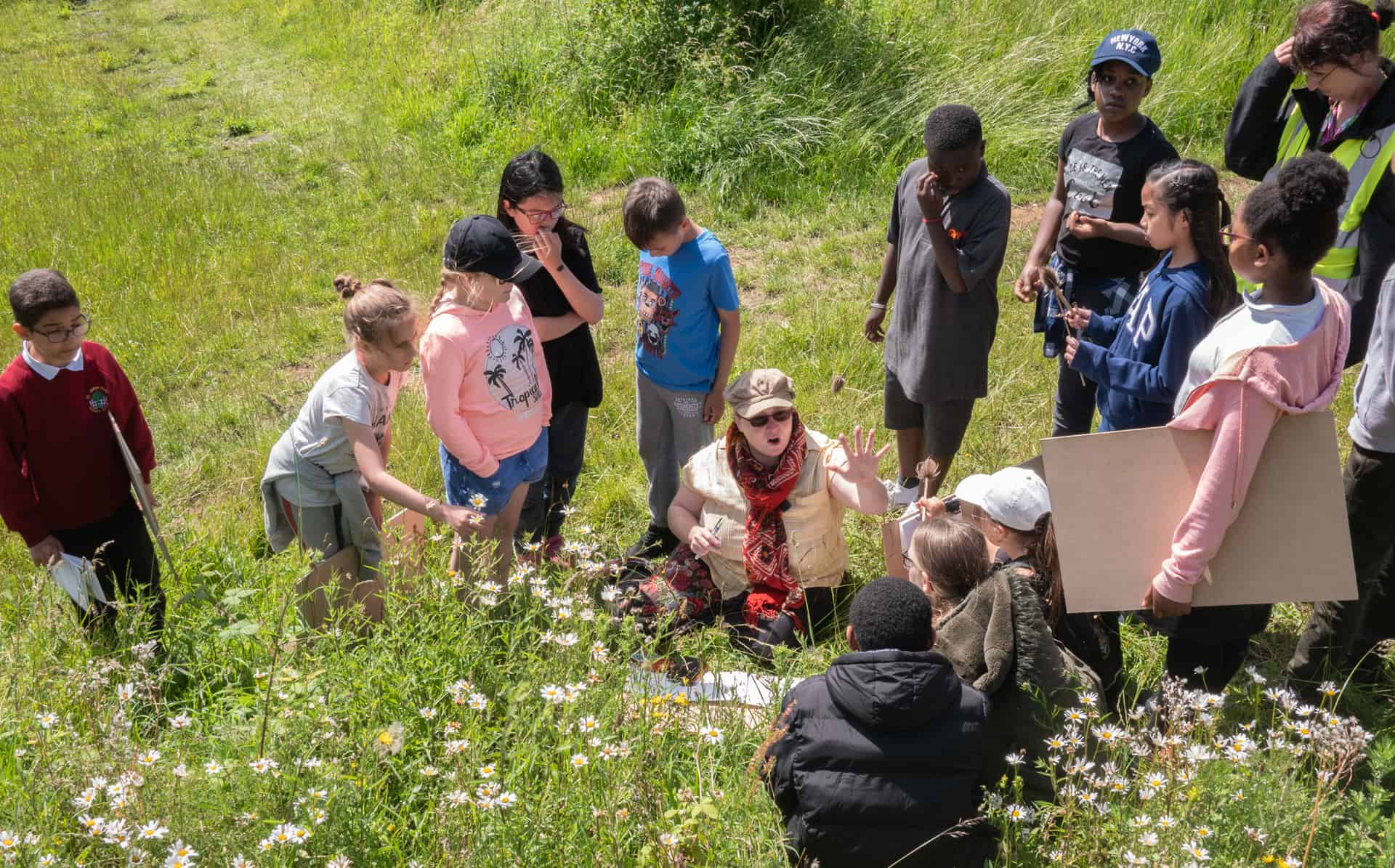 Artist Hannah Boyd working with pupils from St James School, Lion Farm on the Rowley Hills