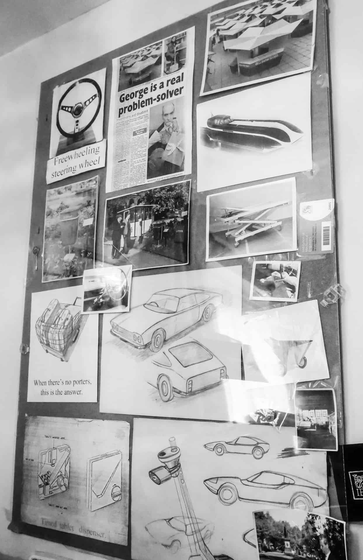 Display showing George's designs and drawings