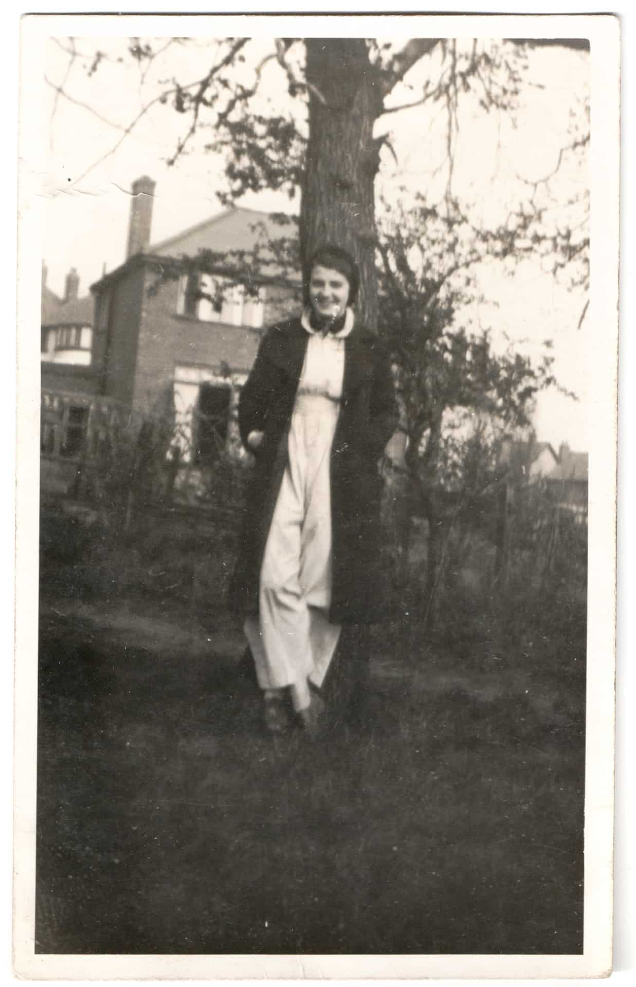This is Auntie Gladys looking very dapper in her glamorous outfits, trousers if you've noticed, which a lot of ladies didn't wear trousers back then. I would say she's about 17, 18, and it was taken at Haden Hill Park at the back of Cradley Heath.