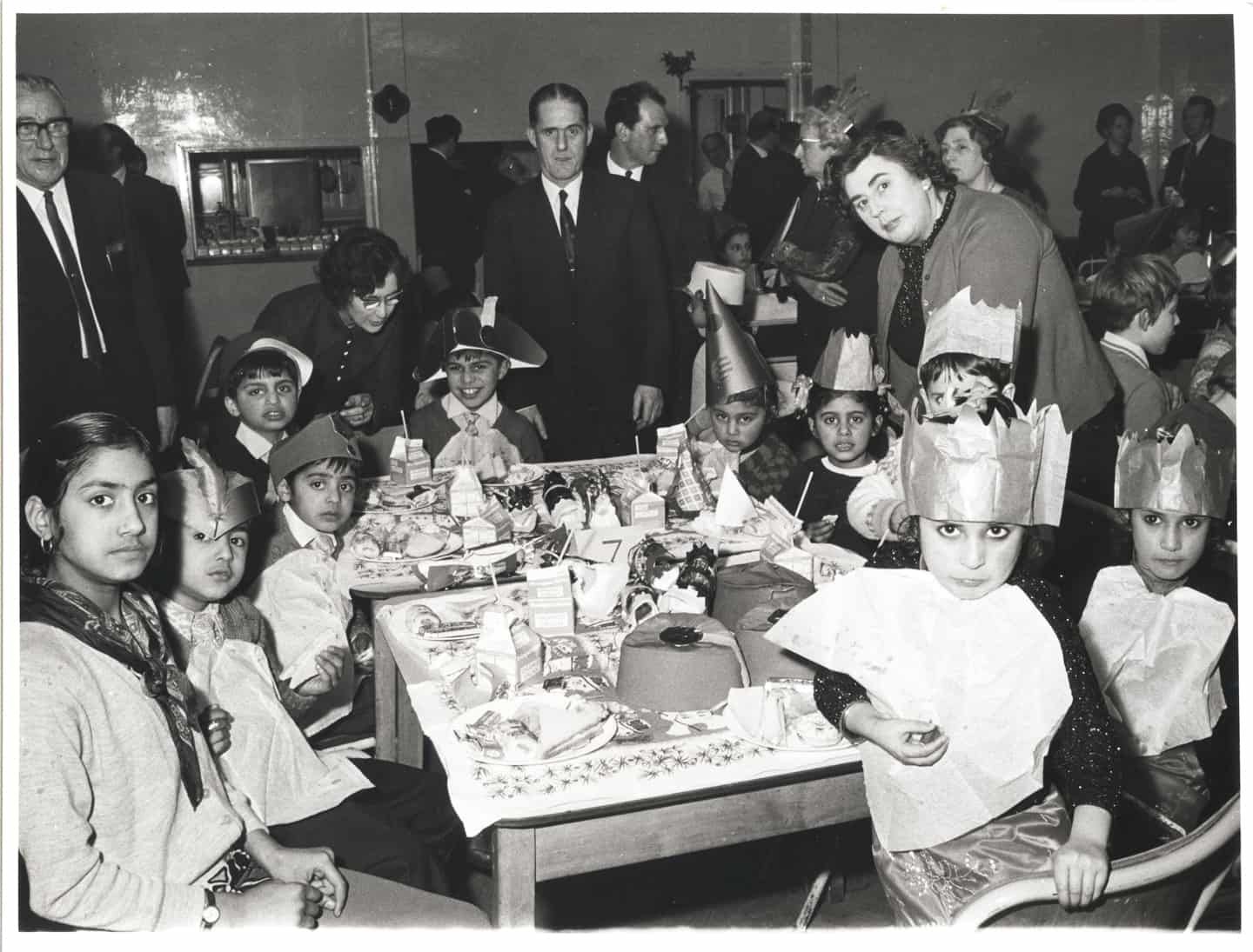 Coneygre Foundry Social Club's annual children's Christmas party for the children of foundry  employees, Dudley c. 1965.  The photographs were photographed by Frank Power, and collated by Stanley Morris (pictured far left) Stanley Morris started working at Coneygre Foundry in 1948 as a Production Controller.  In 1950 he became involved with the Foundry Sports Social Committee and later became the Vice-Chairman. The photos clearly show the children of foundry workers from South Asian Heritage. Amongst the volume of photographs I found depicting this event not a single image showed a picture of the parents of the children from the children.