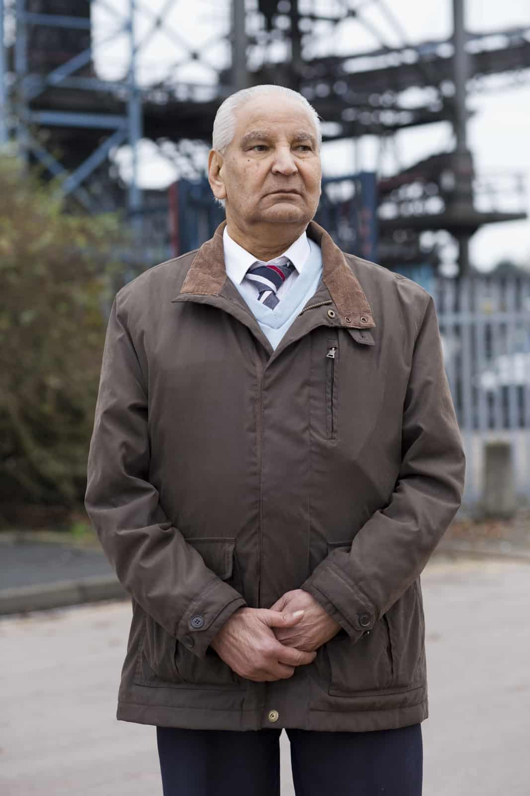 Gurdev Rai (retired) stands outside the Goodyear factory on Stafford Rd , Wolverhampton on a cold 20th December 2016 to support workers leaving on the sad day of the factory's closure. As workers came out one of them included his own son Baljinder Rai for whom he successfully got a job at the plant in 1980, it was an incredibly moving moment in time for all involved.