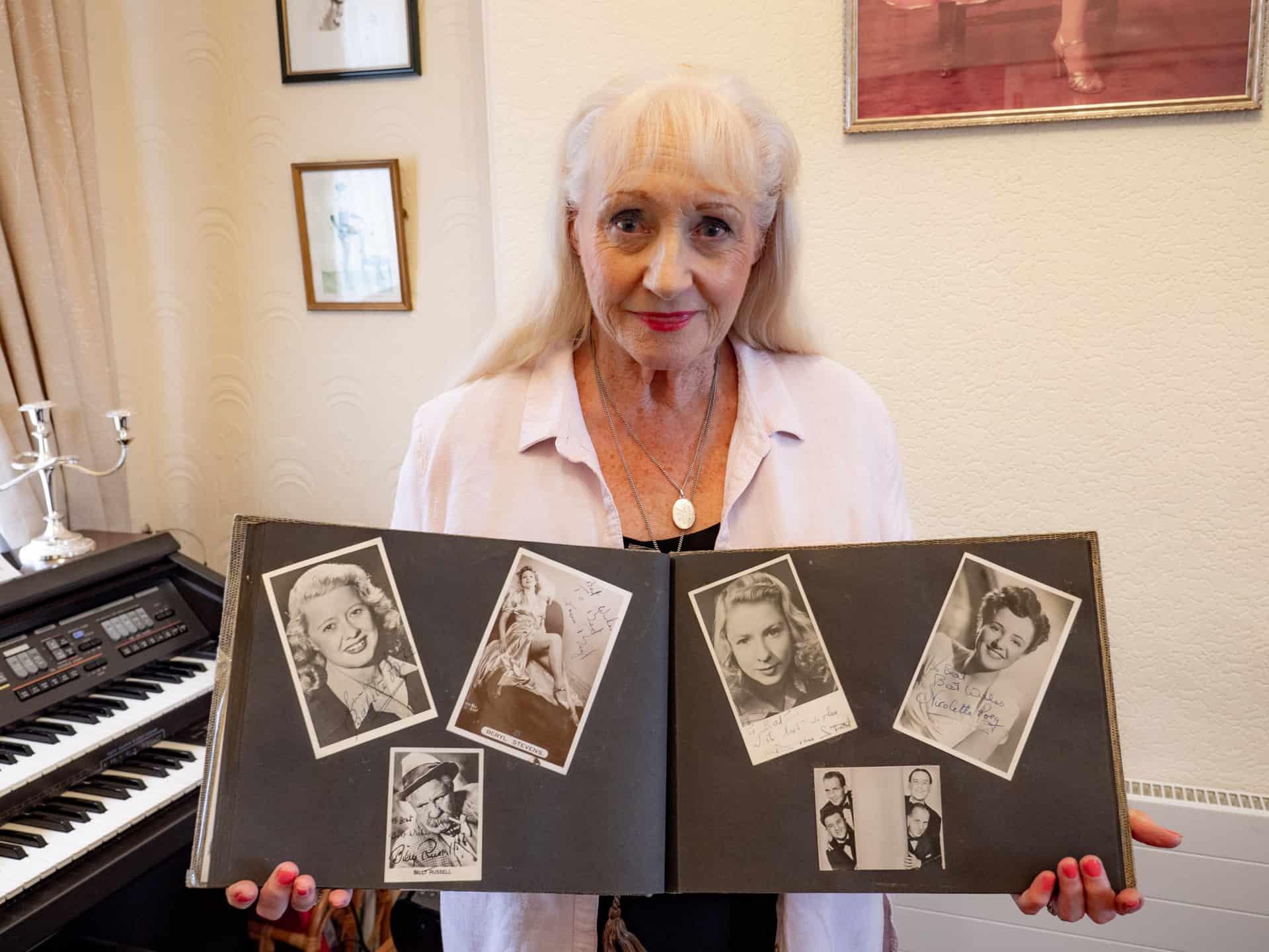 Veronica holding Bert's treasured album.
