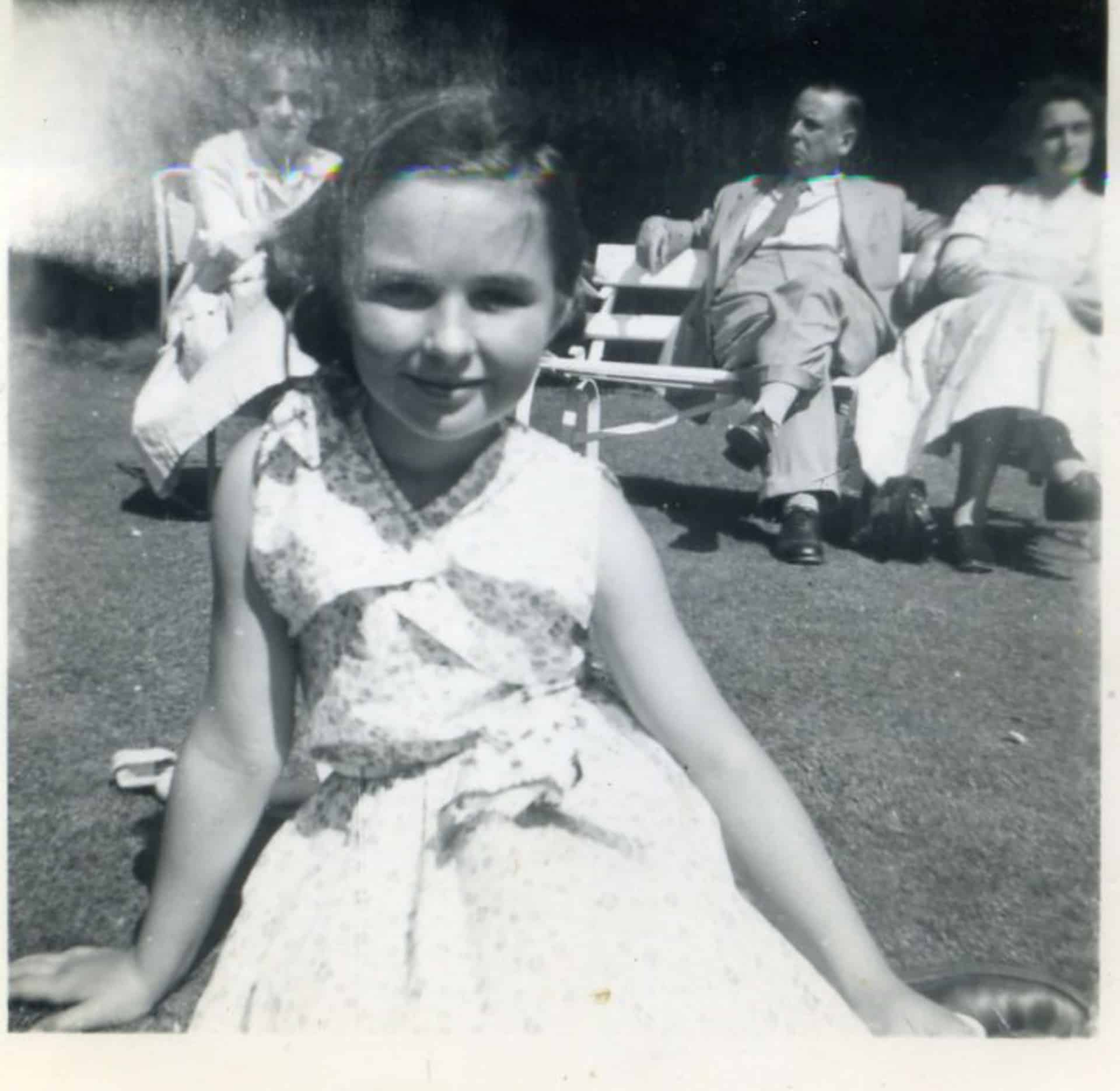 Jenny Potts with her parents in the background, 1952