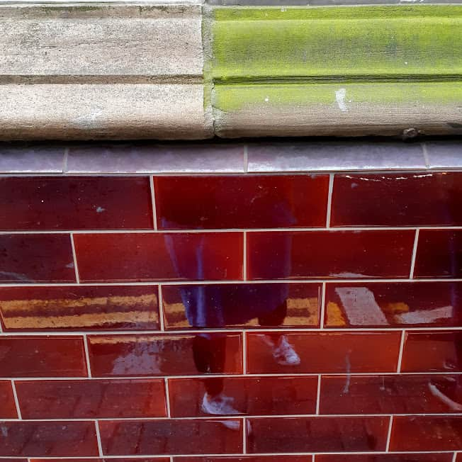 Red exterior wall tiles, Grade II listed former Crown pub, Priory St