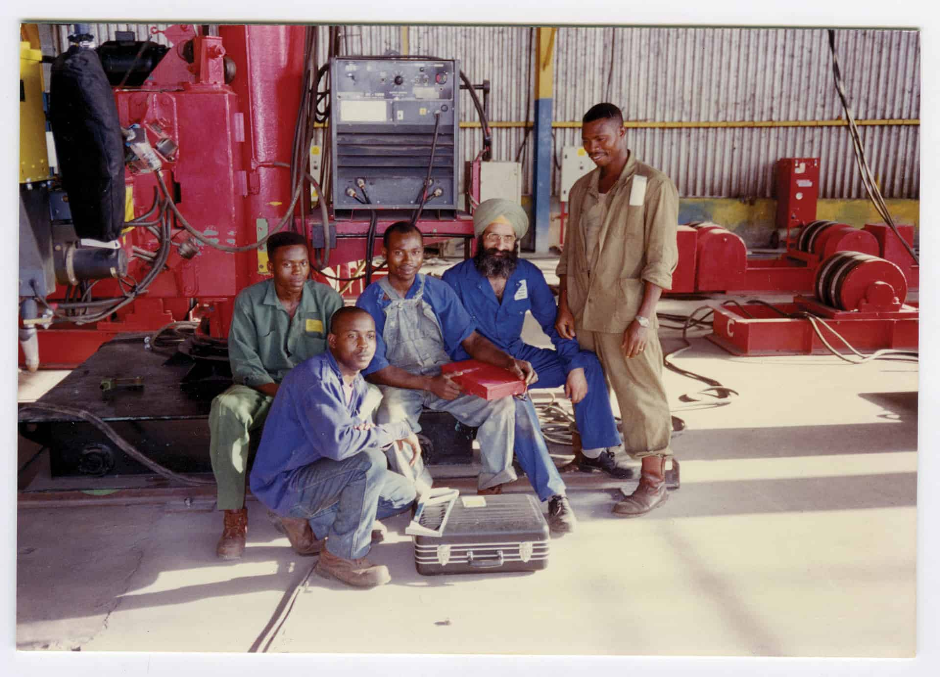 Nirmal Singh with workers in Lagos, Nigeria,c1991. Nirmal trained workers to weld for vessel manufacture