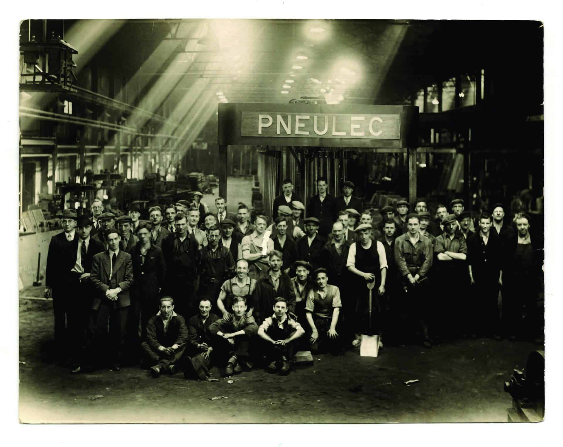 Factory floor of Pneulec, Mafeking Road, Smethwick. Arthur Wilding is seated second from left. Photograph by G. F. Greenfield