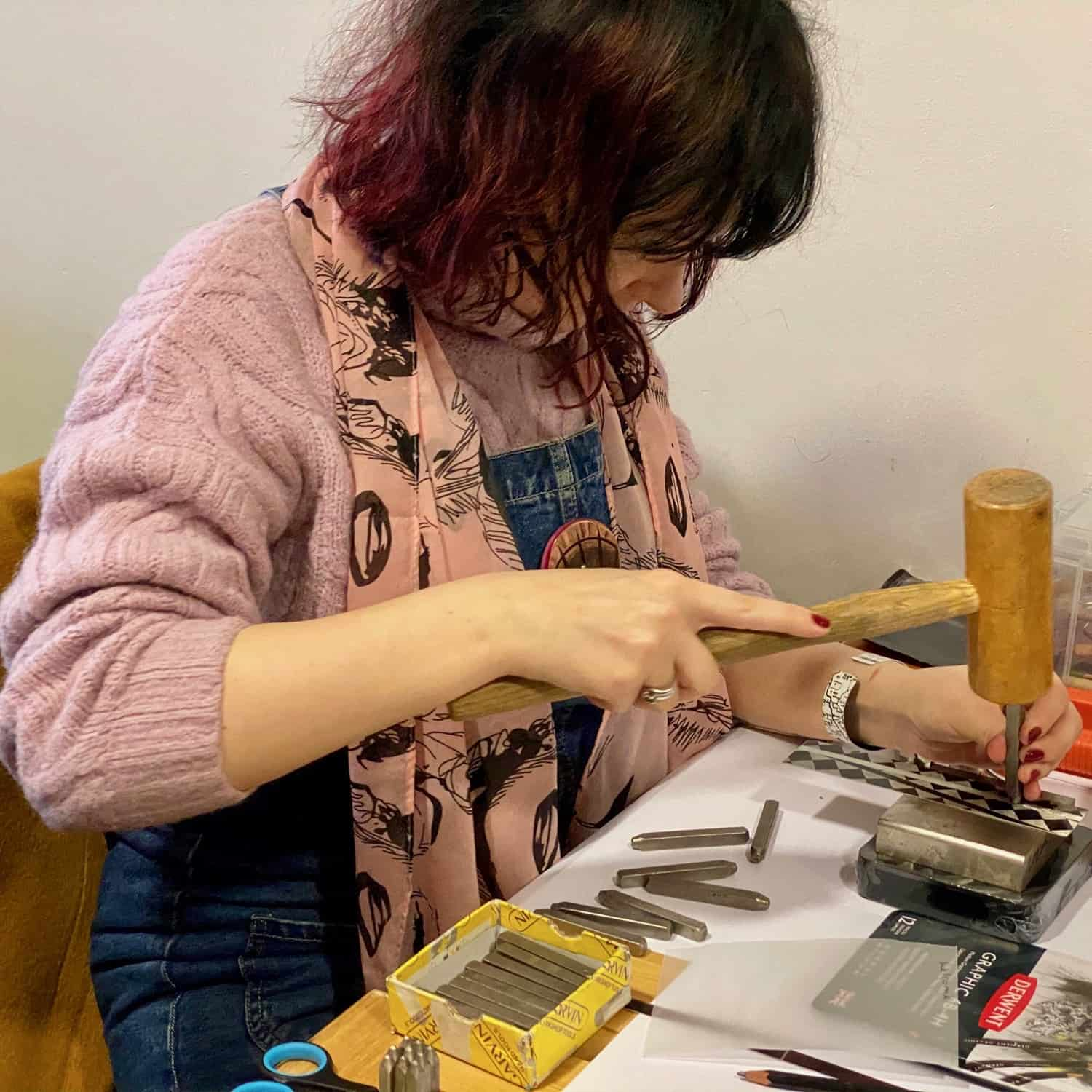 Elle Knowles stamping a bangle